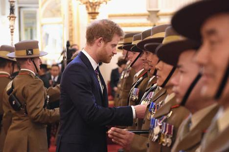 Gurkhas being awarded medals by HRH Prince Harry