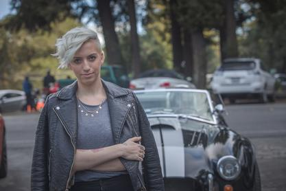 hot rocker badass chick with leather jacket and shelby cobra