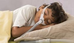 Child sleeping with CPAP