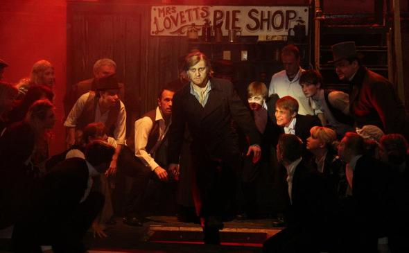 Sweeny Todd (Joseph Tulloch) with ensemble