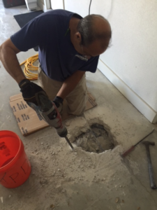 Plumber moving drain line located in slab of home in Lakeway, Texas