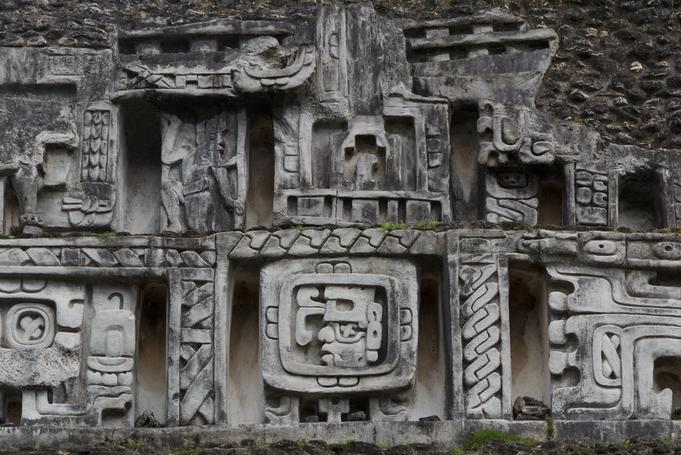 A Maya frieze carved into the side of a Maya temple in the rain forest. Belize Adventure Tours!