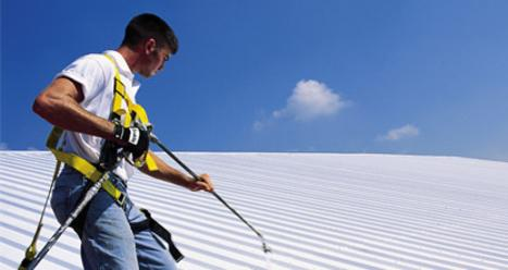 elastomeric roof coating installation in Houston; Houston commercial roofing contractor; elastomeric roof system installation; roofing contractor