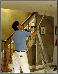 house painter rolling stucco ceiling