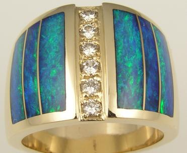 Wide opal ring repaired to perfect condition by Hileman.