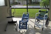 Manual hoist, shower cradle and pool or shower wheelchair