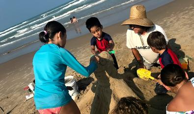 Jose and friends create a sandy octopus