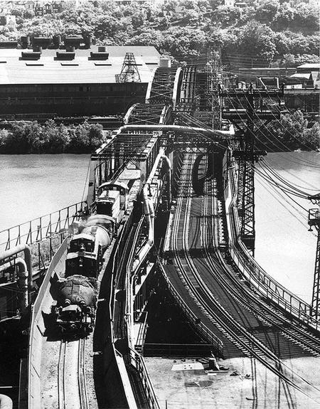 A train of the Monongahela Connecting Railroad makes its way across the Hot Metal Bridge with a load of hot metal bottle cars.