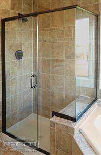 Photo of shower with swing door and notched panel and return