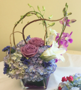 Hydrangea, Lilies, Dendrobium Orchids, and Roses