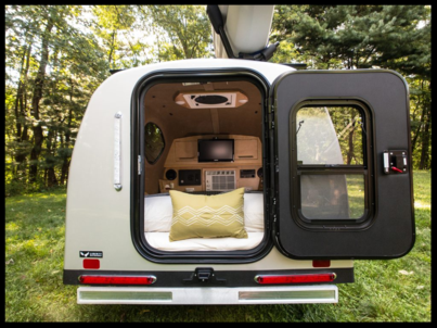 the mypod teardrop trailer set up for camping