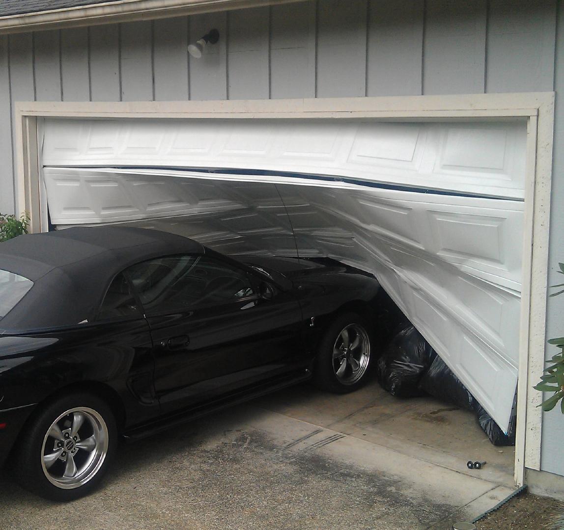 broken garage doorHandyman Garage Doors Openers  Davids Garage Doors  Openers