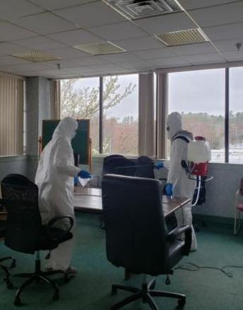 disinfecting office area.