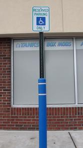 blue handicap bollard sleeve on sign post