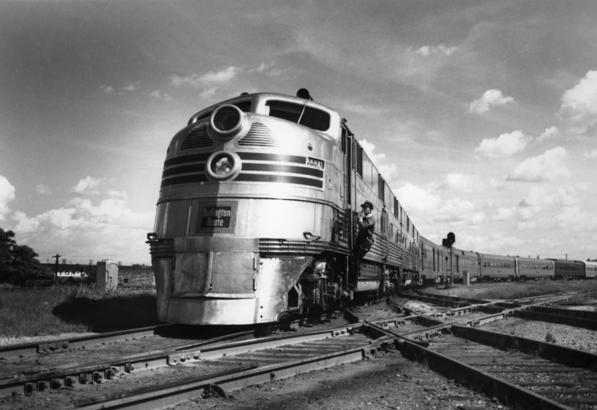 "Fort Worth and Denver Railway's "" Texas Zephyr, train No. 2, northbound, headed by diesel locomotive No. 9990, at Fort Worth, Texas, circa 1950."