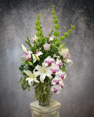Exquisite array of oriental lilies, phalaenopsis, orchids, and roses.