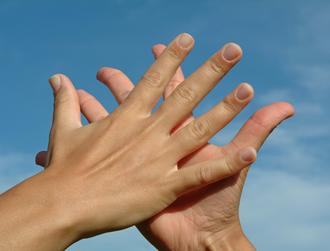 Two hands in a high five to represent connection