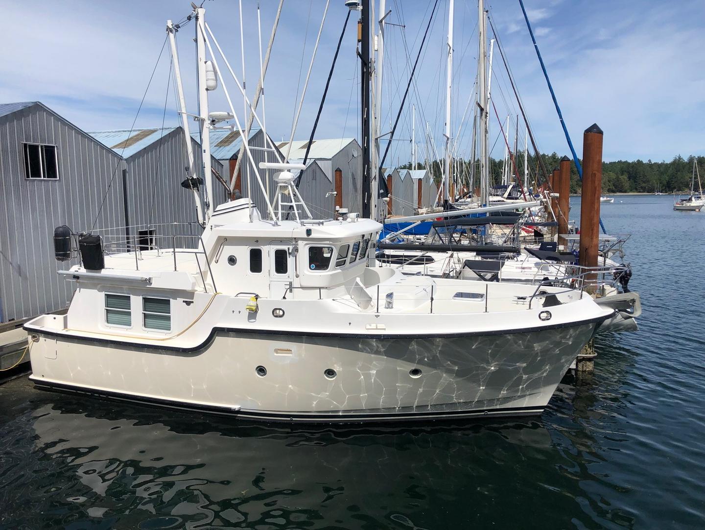 Arbutus Coast Yachts, Power Sail Boathouses - Larry Thompson