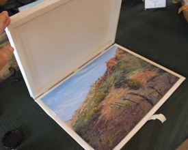 A Lindy C Severns original pastel painting in a protective foam board case ready to box up for shipment.