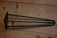 A set of four black epoxy coated hairpin legs