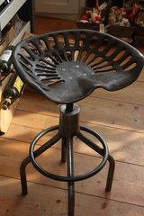 Adjustable height tractor seat stool