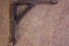 Penny end style cast iron bracket