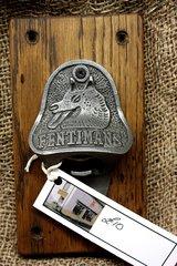 Cast iron Fentimans bottle opener mounted on oak board