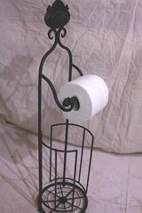 Black metal toilet roll holder.