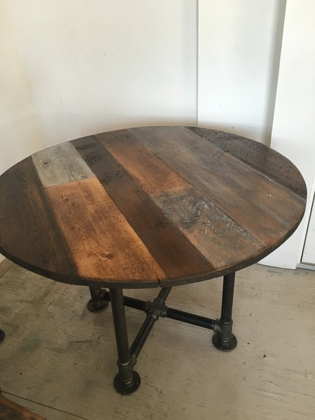 reclaimed wood 42 inch round table top multi wood variety and color variety  with pedestal pipe base. reclaimed wood 42 inch round table top multi wood variety and