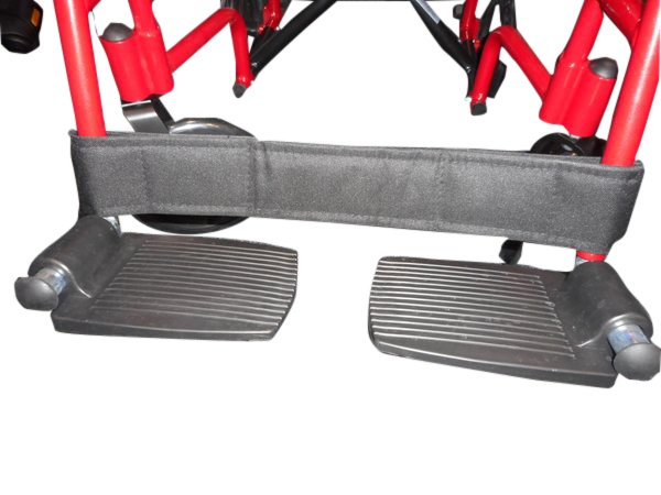 Wheelchair transporter leg strap or footrest strap adjustable.