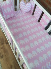 Pink elephant and chevron cot bed set