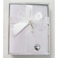 Christening album with silver heart and cross detail