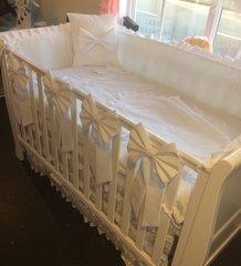 Crisp white cot bedding set