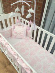 Small pink toile cot bed set including cot mobile & cot bows