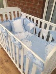 Blue and white broderie anglaise cot bedding set.