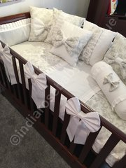 Luxurious white and light grey damask cot bedding set