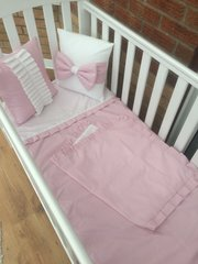 Pink and white plain cot bedding with frilled/bow cushion