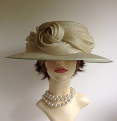 Genevieve Louis Formal Hat by Nigel Rayment large Ladies Pale Green Sinamay Wedding Dress Hat With Large Knot Detail.