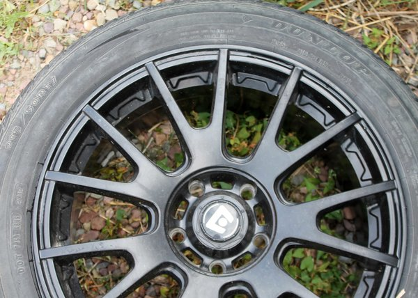 5 Lug Black Wheel w/ 215/50R17 Dunlop Signature II--75% tread