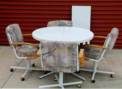 Round Dining Table with leaf and 4-Swivel Chairs