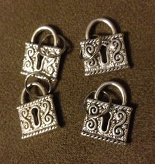 393. Embossed Lock Pendant