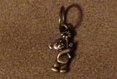 676. Bronze Bear Holding Flower Pendant