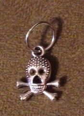 529. Elongated Skull on Crossbones pendant