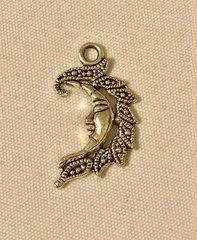 1771. Ornate Moon with Face Pendant