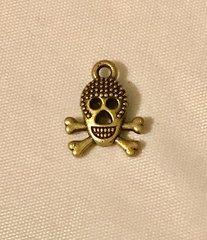 1699. Elongated Skull on Crossbones pendant