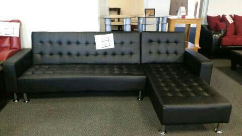 Contemporary black leather sectional sofa Discount Furniture