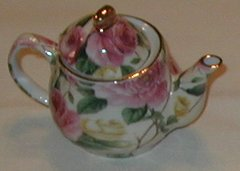 Small collectible tea pot pink and green rose