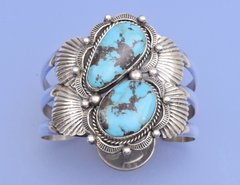 Dead-pawn classic Navajo Sterling cuff with two turquoise stones by Henry Sam.