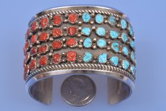 Wide dead-pawn Navajo cuff with Sleeping Beauty turquoise and Mediterranean red coral.—SOLD!