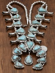 Custom-made squash blossom necklace with No. 8 Mine turquoise by Augustine Largo, Navajo.
